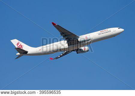 Hong Kong / China - December 1, 2013: Dragonair Airbus A330-300 B-hlj Passenger Plane Departure And