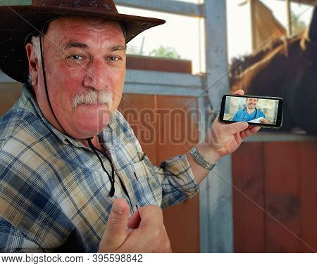 This Old Rancher Is Enjoying The Benefits Of Telemedicine. He Contacts The Remote Doctor By Smartpho