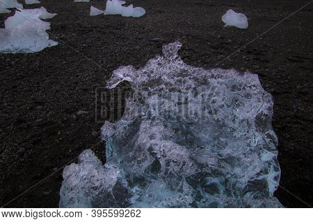 Photo Of A Broken Off Glacier Part In The Glacial Lagoon Of Jökulsárlón, In The South Of Iceland, Wi
