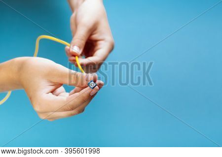 Womans Hands Hold Sc And Fc Connector Fiber Optic Patch Cord Single Mode On Blue Background