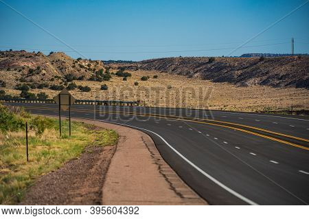 Highway On Travel Vacation. Western Utah Countryside Highway During Hot Summer Day