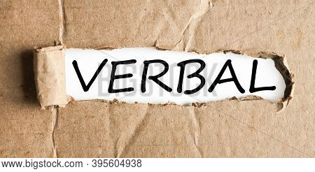 Verbal, Text On White Paper On Torn Paper Background