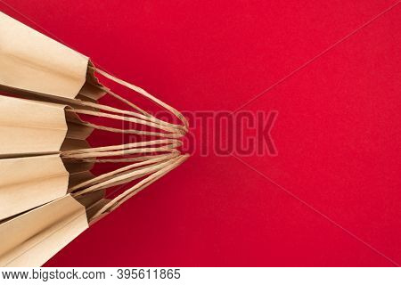 Shopping Concept. Top Above Overhead View Close Up Photo Of Four Craft Paperbags Isolated On Red Bac