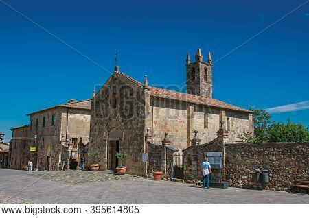 Monteriggioni, Italy - May 13, 2013. People And Church At The Hamlet Of Monteriggioni. A Medieval Fo