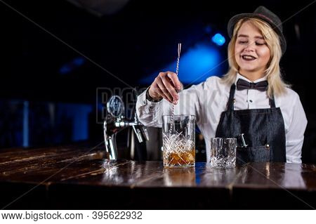 Girl Barman Mixes A Cocktail At The Brasserie