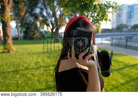 Nice Lady Is Taking Photo With Film Camera
