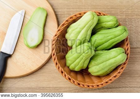 Chayote Squash Or Mirlition Squash On Wooden Cutting Board, Organic Vegetable, Edible Plant Fruit