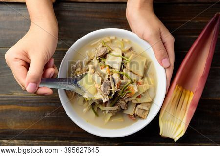 Northern Thai Food (kaeng Hua Plee), Banana Flower Spicy Soup With Pork In A Bowl Holding By Hand An