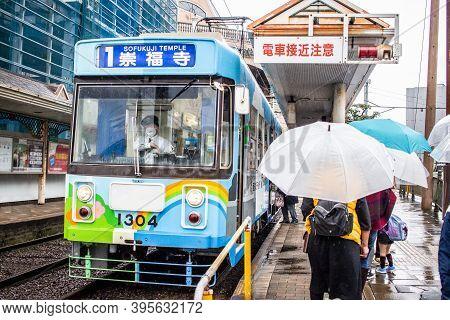 Nagasaki, Japan - 2 November 2020: Colourful Tram On A Rainy Day In Nagasaki
