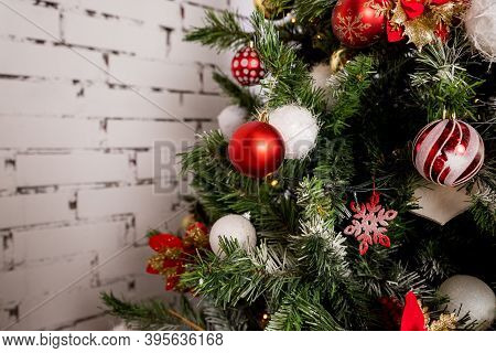 Christmas Tree , Christmas Decorations.colourful Baubles Hanging From New Year Tree.winter Holidays