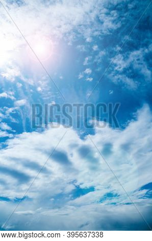 Dramatic blue sky background, vast sky landscape panoramic scene with rays of light. Blue sky background, vast sky landscape, sky scene with dramatic clouds.
