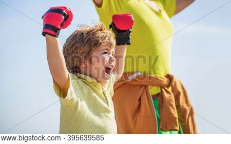 Little Boy Doing Boxings Exercise With Grandfather. Father Is Training His Son Boxing. Little Boy Sp