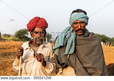 November 2019 Pushkar,rajasthan,india. Portrait Of Two Man Smoking At Pushkar Camel Festival.
