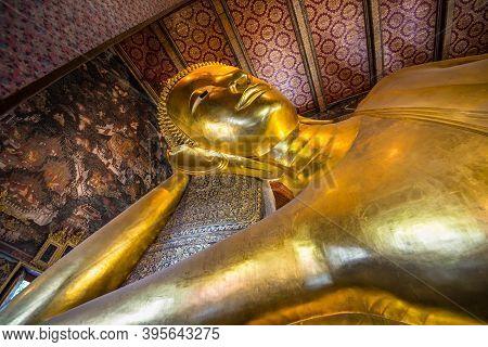 Bangkok, Thailand - December 7, 2019: Golden Buddha Statue In Thailand Buddha Temple Wat Pho (temple