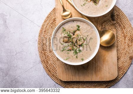 Homemade Mushroom Cream Soup. Top View. Cream Soup With Mushrooms, Cream And Porcini Mushrooms. Wild