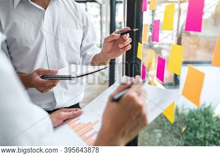 Business Team Working Marketing Growth On Financial Document Graph Report Statistics, Using Post It