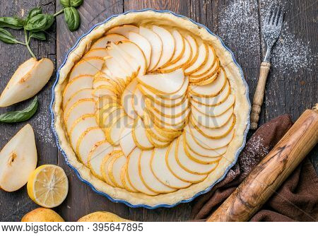 La Tarte Bourdaloue - French Pear Tart Or Pie With Fresh Pear Fruits. Home Baked French Style Desser