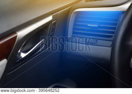 Car Air Conditioning Concept. Cold Air From The Vent Panel Grille Of A Modern Car.