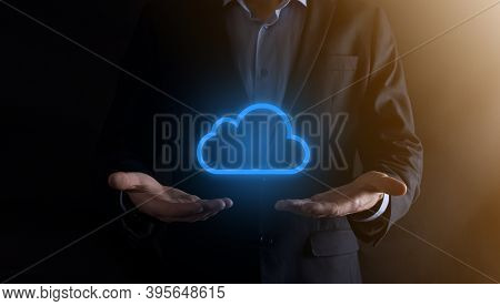 Businessman Hand Holding Cloud Computing Concept In Palm. Backup Storage Data Internet, Networking A