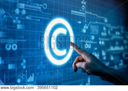 Concept Of Copyright And Intellectual Property On A Digital Display.