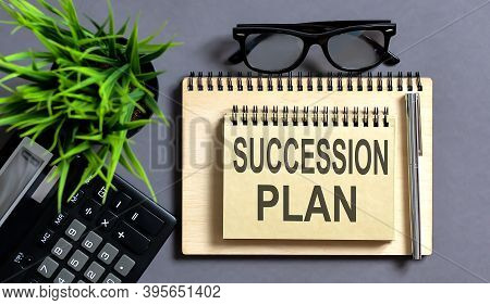 Text Succession Plan On Notepad With Office Tools, Pen