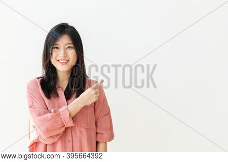 Cheerful young woman with a design space