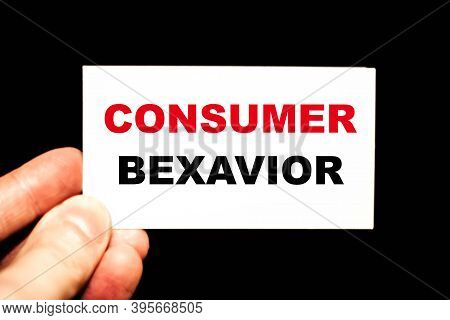 Consumer Behavior. A Man's Hand Holds A Business Card With The Words For Business.