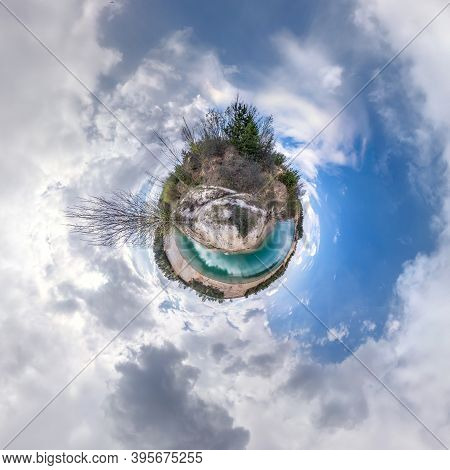 Green Tiny Planet In Blue Sky With Beautiful Clouds. Transformation Of Spherical Panorama 360 Degree