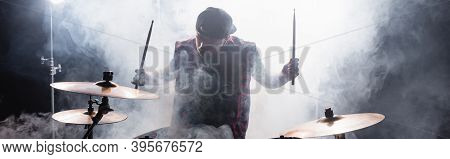 Musician With Drumsticks Sitting At Drum Kit With Smoke On Black Background, Banner, Stock Image