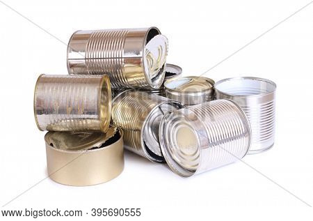 Heap of old empty cans on a white background. Isolated objects