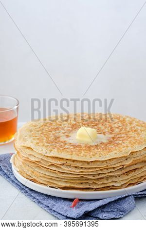 Crepes, Thin Pancakes With Honey And Butter On A White Plate. Close Up.