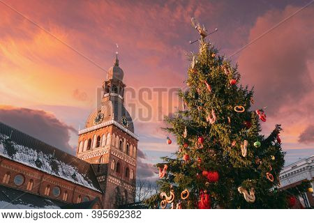 Riga, Latvia. Christmas Market On The Dome Square With Riga Dome Cathedral. Christmas Tree And Famou