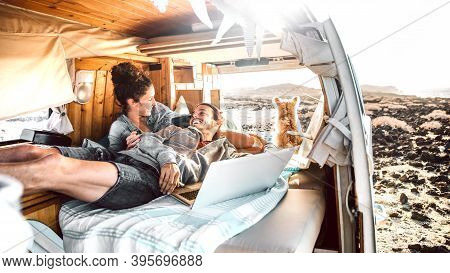 Hipster Couple With Dog Traveling Together On Retro Mini Van Transport - Digital Nomad Concept With