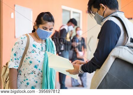 University Students In Medical Mask Discussing At College Corridor - Concept Of College Reopen After