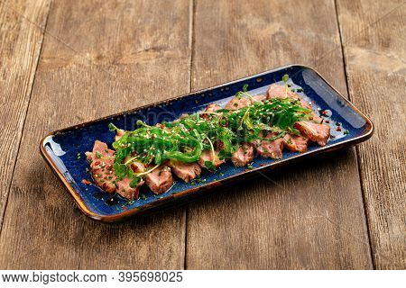 Sliced Tataki Roast Duck Breast With Seaweed Chuka On The Wooden Background