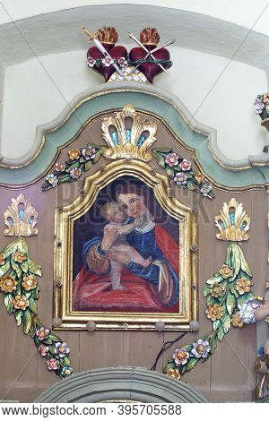SVETI PETAR MREZNICKI, CROATIA - JULY 14, 2013: Virgin Mary with baby Jesus, altarpiece at the altar Our Lady of Sorrows at St. Peter's Parish Church in Sveti Petar Mreznicki, Croatia
