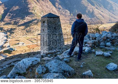 Traveler Enjoys The View From Medieval Tower Fortress Abay-kala