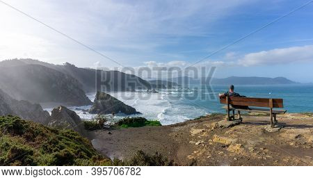 A Man Relaxing And Enjoying The Vie At The Cliffs Of Loiba In Galicia