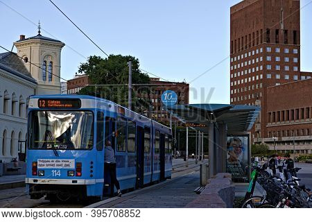 Oslo, Norway - Aug. 29th 2020: City Tram At A Stop In Oslo, City Hall In The Background.
