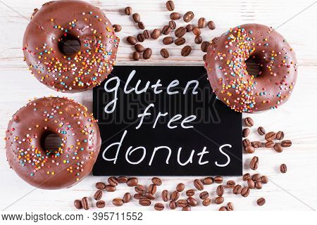 Gluten Free Healthy Chocolate Donuts With Coffee Beans. Gluten-free, Soy Free Product. Top View