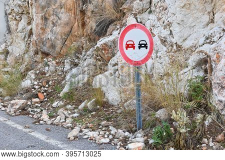 Overtaking Sign Is Prohibited In The Mountains, The Danger Of Rock Collapse. Dangerous Rockfall Road