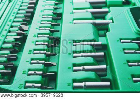 Mechanics Tool Set And Mechanic's Tool Box Close-up. Plastic Green Storage Box Case. Mechanics Tool