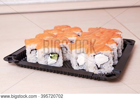 Philadelphia Classic. Salmon, Philadelphia Cheese, Cucumber, Avocado, Tobiko. Japanese Sushi