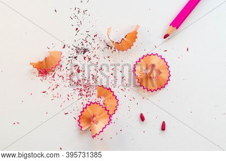 Pink Pencil Along With The Remains Of Wood After Having Been Sharpened