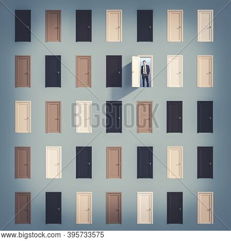 many different doors, open door with smiling businessman. Concept of choice and success.