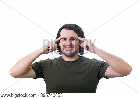Young Man, Keeps Fingers To His Temples, Clenching Teeth As Feels Head Pain. Person Suffering Headac