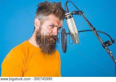 Man Recording In Studio. Bearded Man Sing In Microphone. Karaoke. Man Singing With A Microphone. Sin