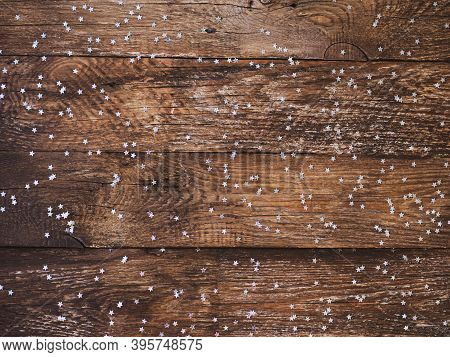 Vintage Christmas Rustic Wooden Background. Planked Wood With Christmas Confetti Silver Stars. Space