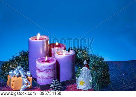 Close Up View Of Christmas Burning Candles And Decoration Objects. Postcard. Christmas And New Year