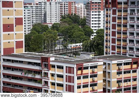 Singapore- 14 Nov, 2020: Singapore Residential Housing Estate With Apartment Blocks Against A Cloudy